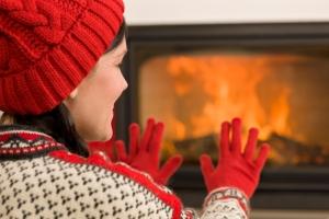 OverShoulder_Brunette_Woman_Warming_ByFire