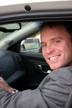 car-man-smiling-and-driving