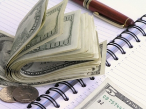 money-wads-and-notebook