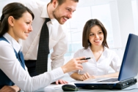 young_businesspeople_discuss_atlaptopshutterstock_71639383