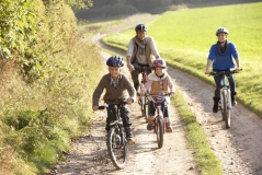 family-bike-shutterstock_68250760