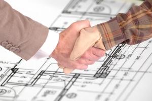carpenter-shaking-hands-shutterstock_69876982