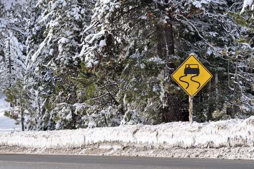 snowy-road-sign-shutterstock_91666661