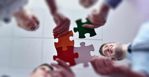 business-team-assemble-puzzle-fb--shutterstock_129809678