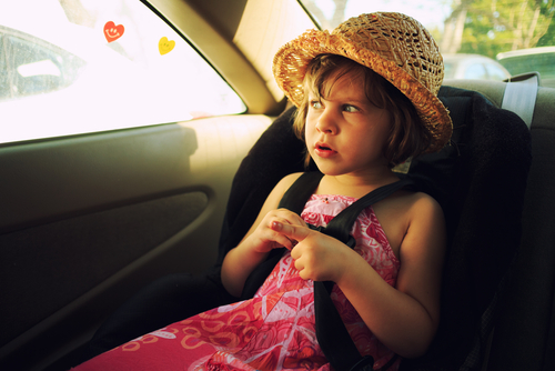 littlegirl-hot-seat-car-shutterstock_191341415